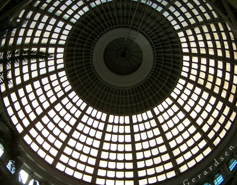 An architectural glass dome seen from under