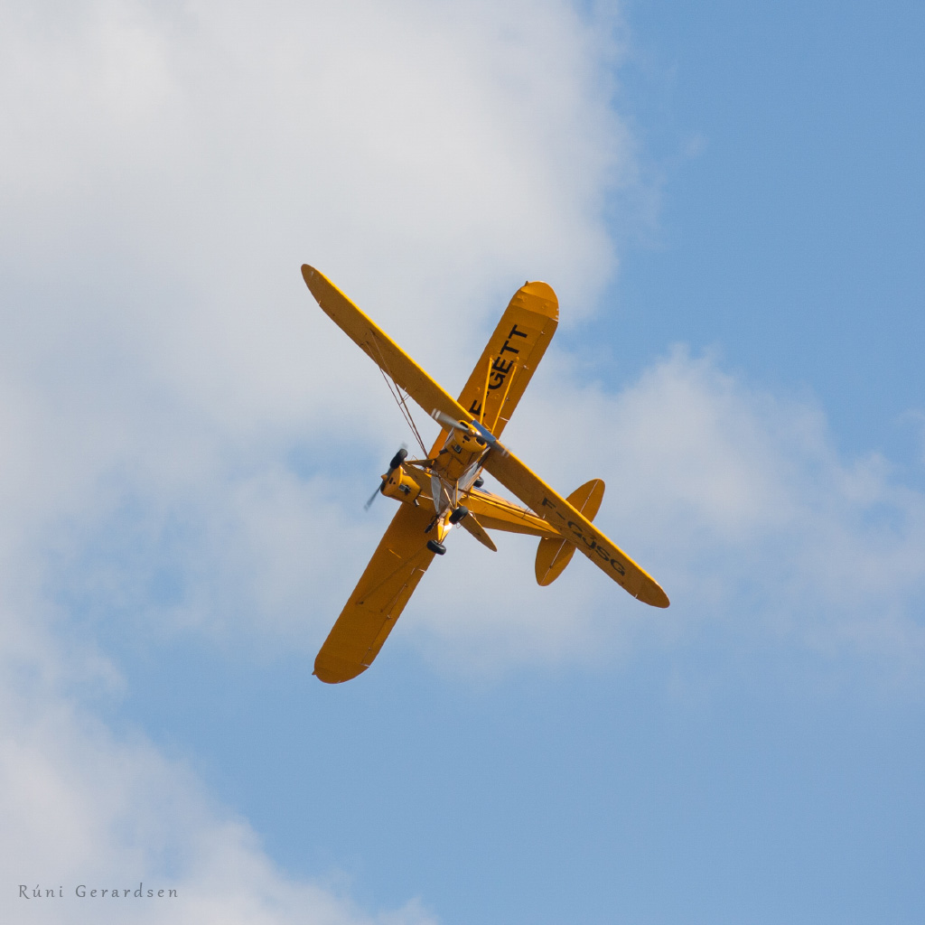 Two yellow planes crossing and visually forming an X